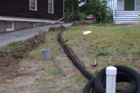 Laying pipe for rain garden