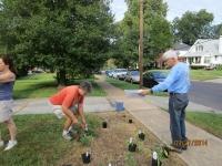 Kathy and Alan placing plants