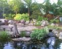 Backyard pond, patio and playground