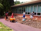 Students preparing to plant native plants at Principia School