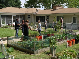 People touring a backyard garden on the 2011 Sustainable Backyard Tour
