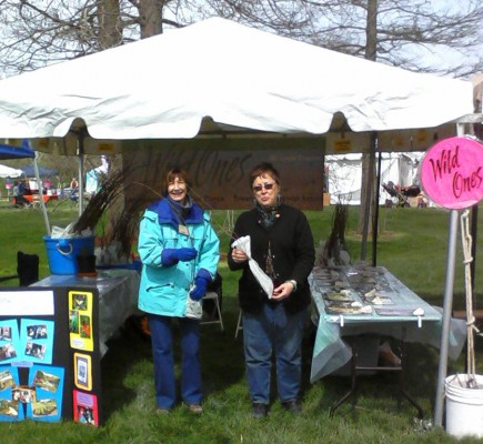 Wild Ones members with free seedlings at the 2013 Earth Day booth in Forest Park