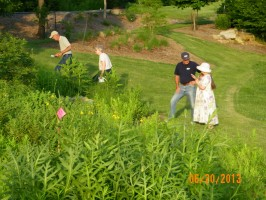 people enjoying an evening in a prairie planting