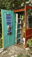 Garden shed made of recycled doors - inside view