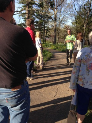 Participants at the April event tour the garden with Scott Woodbury