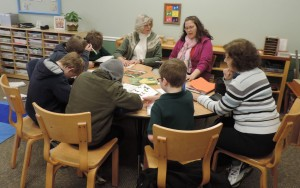 Students and teacher from Campbell Montessori School meet with Wild Ones members to discuss their grant proposal