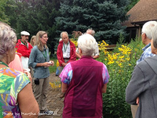 Heather Holm, keynote speaker, and attendees on the prairie walk